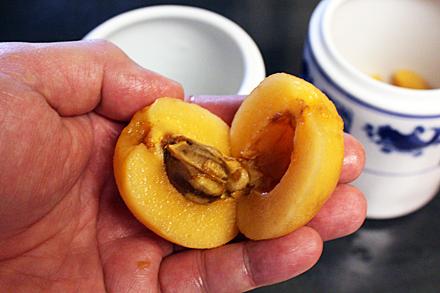 Loquat halves revealing seeds